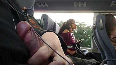 cumflash next to indian girl in bus