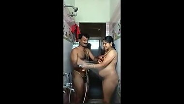 Indian Pregnant Woman with her husband in bathroom